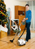 Adult couple cleaning in home Royalty Free Stock Images