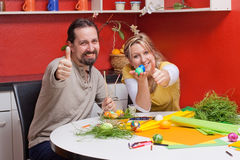 Adult couple with Easter eggs lifts thumb Royalty Free Stock Photo
