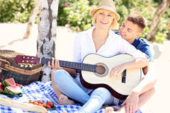 Adult couple and guitar Royalty Free Stock Photos