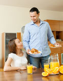 Adult couple having breakfast. In home royalty free stock photos