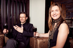 Adult Couple Having A Glass Of Wine. In a restaurant stock photography