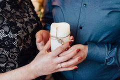 Adult couple holding hands with a candle Royalty Free Stock Images