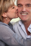 Adult couple kissing. At home stock photos