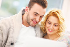 Adult couple with laptop in living room Royalty Free Stock Photo