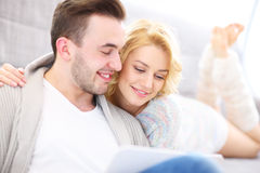 Adult couple with laptop in living room Royalty Free Stock Images