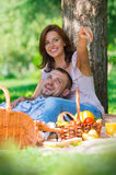 Adult couple picnicking Stock Images
