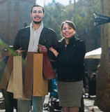 Adult couple with purchases Royalty Free Stock Images