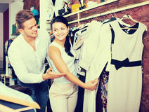 Adult couple purchasing jacket and dress Royalty Free Stock Photo