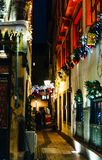 Adult couple rading menu restaurant outdoor street Christmas. STRASBOURG, FRANCE - DEC 20, 2016: View of Christmas Street with couple reading the menu at the Royalty Free Stock Photo