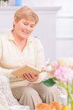Adult couple reading book Stock Photo