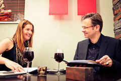 Adult Couple Reading The Menu. In a restaurant stock photos