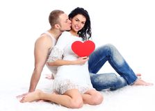 Adult couple with red heart  on the floor Stock Images