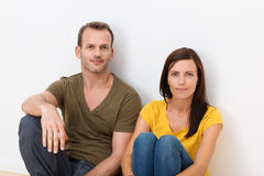 Adult couple sitting in the floor Royalty Free Stock Image