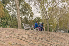 Adult Couple Sitting at Park in Montevideo, Uruguay Royalty Free Stock Images