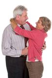 Adult couple smiles. And hugs each other stock photography