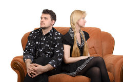 Adult couple on the sofa. Happy adult couple on the sofa. Isolate on white Royalty Free Stock Photography