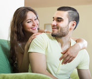 Adult couple on sofa in home Royalty Free Stock Photo