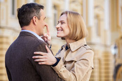 Adult couple standing on street and hugging. Royalty Free Stock Image