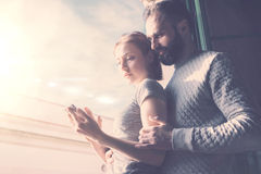 Adult couple summer journey. Photo woman and bearded man using mobile phone. Girl touching screen contemporary Royalty Free Stock Photo