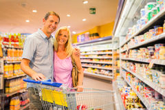 Adult Couple At The Supermarket. Adult couple buying groceries at the supermarket royalty free stock photography
