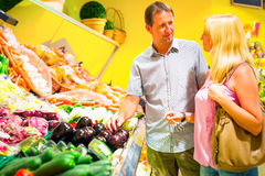 Adult Couple At The Supermarket. Adult couple buying groceries at the supermarket stock photography