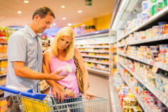 Adult Couple At The Supermarket Stock Photos