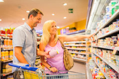 Adult Couple At The Supermarket Stock Images