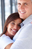 Adult couple sweetly hugging each other Royalty Free Stock Images