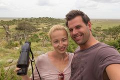 Adult couple taking selfie on african wildlife safari in Serengeti national park, Tanzania, Africa. Royalty Free Stock Photos