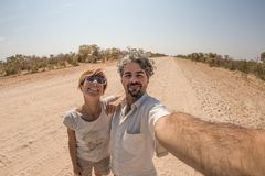 Adult couple taking selfie in the Namib desert, Namib Naukluft National Park, main travel destination in Namibia, Africa. Adult couple taking selfie in the Royalty Free Stock Images