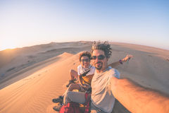 Adult couple taking selfie on sand dunes in the Namib desert, Namib Naukluft National Park, main travel destination in Namibia, Af Royalty Free Stock Photography