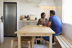 Adult couple talk and drink wine in the kitchen, copy space Stock Images