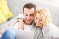 Adult couple using laptop at home Royalty Free Stock Images