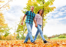 Adult couple walk in the park Royalty Free Stock Photo