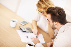 Adult couple working on documents Stock Photos