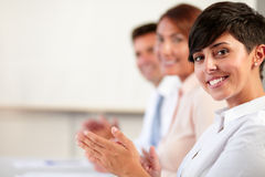 Adult coworker team smiling and giving applause Stock Photos