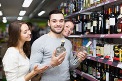 Adult customers choosing vodka Royalty Free Stock Photo