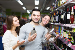 Adult customers choosing vodka Stock Photography