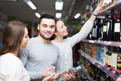 Adult customers choosing vodka Stock Photo