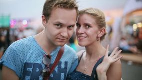 Adult cute woman and blonde man smiling in camera. Dating couple. Summer evening. Portrait stock video