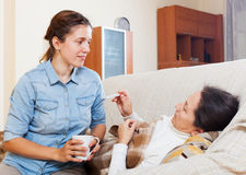 Adult daughter caring for sick mother Stock Photo