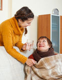 Adult daughter caring for unwell mother Stock Image