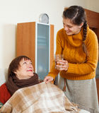 Adult daughter caring for unwell mother Royalty Free Stock Photo
