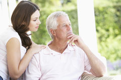 Adult Daughter Comforting Worried Father Royalty Free Stock Photos