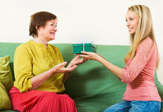 Adult daughter congratulating happy mother. Adult daughter congratulating happy senior mother on birthday Royalty Free Stock Photo