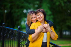 Adult daughter with the elderly mother royalty free stock photography