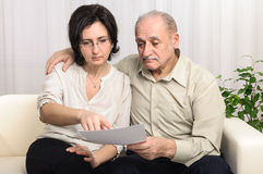 Adult daughter helping sad elderly man Royalty Free Stock Image