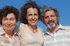 Adult daughter and her parents Stock Image