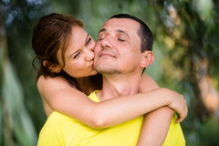 Adult daughter kissing and hugging her father. Loving hearts. Stock Photo