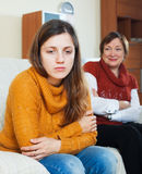 Adult daughter and  mother having conflict. Sad adult daughter and mature mother having conflict Stock Image